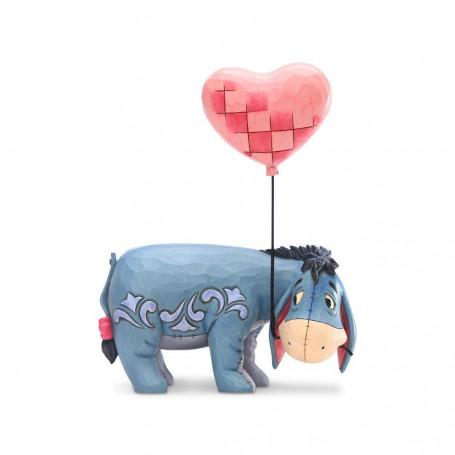 Enesco - Winnie l'Ourson Bourriquet et le ballon en coeur - Eeyore with a Heart Balloon - Disney Tradition by Jim Shore